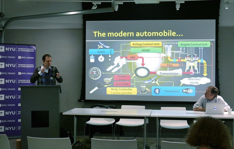 Justin presenting his work on automobile security